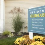 Clubhouse sign at Broadleaf Boulevard Apartments in Manchester