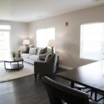 Dining and living room at Broadleaf Boulevard Apartments in Manchester